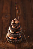 Wild haselnut in iron bowls stacked on wooden table Stock Photo