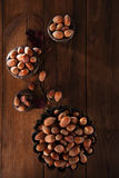 Wild haselnut in iron bowls on wooden table Stock Photography