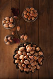 Wild hazelnut in iron bowls on wooden table Stock Photography