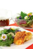 Wild herb salad. With goat cheese baked in a potato crust Royalty Free Stock Photos