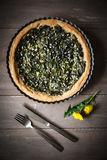 Wild herb spinach quiche, vegetarian, baking dish Stock Images