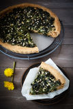 Wild herb spinach quiche, vegetarian, cooling grid Royalty Free Stock Photo