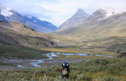 Into the Wild. Hiker walking into the Arctic wilderness in Sarek, Sweden Stock Photo