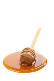 Wild honey and wooden dipper isolated Stock Photography