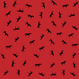 Wild horses on a red background Royalty Free Stock Photo