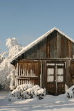 Wild human life. Small timber cottage seems the best for short winter holidays, extreme way of life Stock Photo