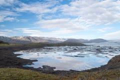 Wild Icelandic landscape with ice lagoon. Royalty Free Stock Photos