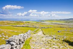 Wild Irish landscape with stone trail to the ocean Aran Island. Ireland Stock Images