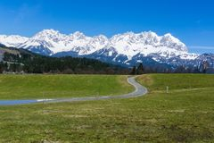 Wild Kaiser with snow cover in Austria Tyrol hiking trail stock photos