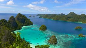 The wild lagoon of Wayag, Raja Ampat, west papua, Indonesia. Isolated and amazing lagoon in of wayag, Raja Ampat, west Papua, Indonesia royalty free stock photography