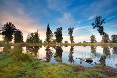 Wild lake and blue morning sky Royalty Free Stock Photo
