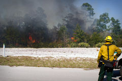 Wild Land Fire. A Florida Forestry Fire Fighter observes a fire in a wild land area of north Florida Royalty Free Stock Photography