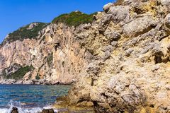 Wild landscape of rocky hills on the sea coast Stock Images