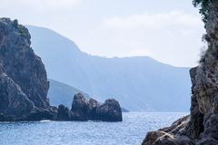 Wild landscape of rocky hills on the sea coast Royalty Free Stock Images