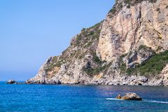 Wild landscape of rocky hills on the sea coast Stock Image