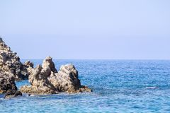 Wild landscape of rocky islands in the sea Stock Photography