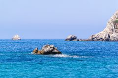 Wild landscape of rocky islands in the sea Stock Photos