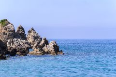 Wild landscape of rocky islands in the sea Royalty Free Stock Image