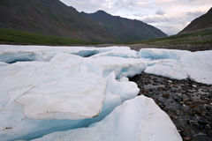 Wild landscape, Russia. Ice glacier blocks,stones. Stock Photos