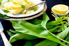 Wild leek with saffron basmati rice and lemon Stock Images