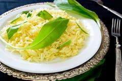 Wild leek with saffron basmati rice and lemon Royalty Free Stock Image