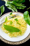 Wild leek with saffron basmati rice and lemon Stock Photo