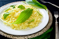 Wild leek with saffron basmati rice and lemon Royalty Free Stock Photos