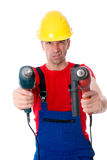 Wild man with helmet and drilling machine. Wild man with helmet and two drilling machine Royalty Free Stock Photos
