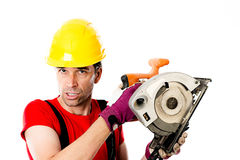 Wild man with helmet and electric saw Royalty Free Stock Photography