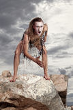 Wild man stands on a rock Royalty Free Stock Photography