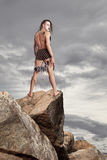 Wild man stands on a rock Royalty Free Stock Photos
