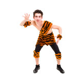 Wild man wearing a tiger skin Royalty Free Stock Photo