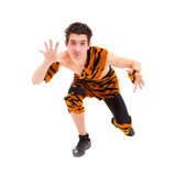 Wild man wearing a tiger skin Stock Image