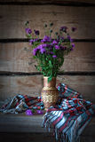 Wild meadow flowers cornflowers in a vase straw in the old farm Stock Images