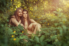 Wild men in the bushes. Wild men and women sitting in the woods in the bushes Royalty Free Stock Photo