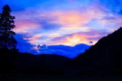 Wild Montana Big Sky. Sunset over western Montana`s Sapphire Mountains, Rocky Mountains, fir trees, pines Stock Image