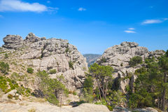 Wild mountain landscape, rocks under blue sky Stock Images