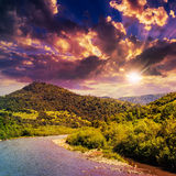 Wild mountain river on a clear summer evening Stock Photos