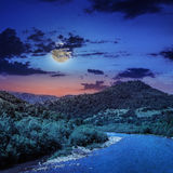 Wild mountain river on a clear summer night Stock Photography