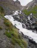 Wild mountain stream in a steep slope Stock Photo