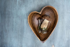 Wild mushroom in heart shape plate on a wooden background, bolet Royalty Free Stock Photography