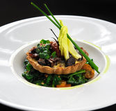 Wild mushroom tartlet with vegetable salad Royalty Free Stock Photo
