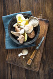 Wild mushroom on wooden table Royalty Free Stock Photography