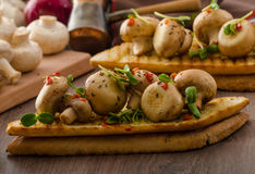 Wild mushrooms on toast Stock Photo