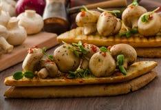 Wild mushrooms on toast Stock Photo