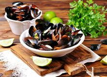 Wild mussels with white wine, vegetables, lime and parsley Stock Image