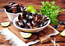 Wild mussels with white wine, vegetables, lime and parsley Royalty Free Stock Images