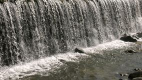Wild natural waterfall. Video and stones stock video