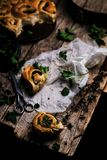 Wild nettle  whole wheat kissed buns. Style rustic. Wild nettle  WHOLE WHEAT  kissed  BUNS.. Style rustic. selective focus Stock Photography