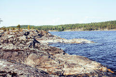 Wild north nature landscape. lot of rocks on lake shore Stock Photo
